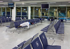 Passenger sleeps on seats in an empty night airport Stock Photo