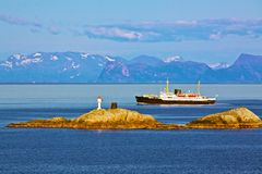 Passenger steamer. Passenger ship Hurtigruten in Norway sailing along the coast Royalty Free Stock Photography