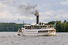 Passenger steamer S/S Mariefred underway. In Lake Mälaren, Sweden. S/S Blidösund was built in Stockholm 1903, still in traffic with it´s original coal-fired Royalty Free Stock Photo