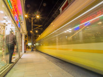 Passenger street tram departing Stock Photo
