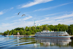 Passenger tourist ship standing at the pier on island of Valaam Stock Image