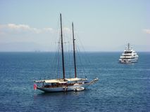 Passenger and tourist ships in the ionian sea sailing away. Passenger and tourist ships in the ionian sea sailing away Royalty Free Stock Photography
