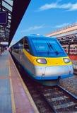Passenger train. Blue passenger train on the station royalty free stock image