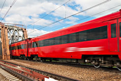 Passenger train. Suburban electric train at railway in motion Royalty Free Stock Image