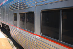 Passenger train. Side of a passenger car on a train in the western USA Stock Image