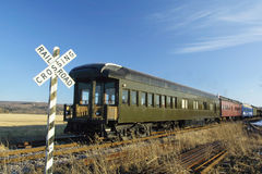 Passenger Train. A passenger train passing a through railroad crossing Royalty Free Stock Photography