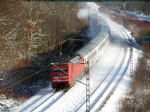 Passenger train. At speed on rails by a winter morning Stock Photography