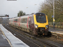 Passenger train approaching a station UK Stock Image