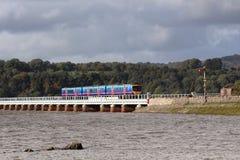 Passenger train Arnside viaduct at high tide Stock Photo