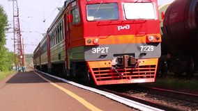Passenger train arrives. PERM, RUSSIA - MAY 30, 2015: Passenger train arrives. Russian Railways is largest employer in Russian stock video footage