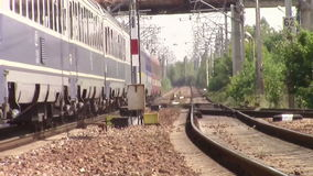 Passenger train arriving in hot summer day stock footage