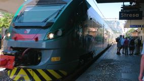 Passenger train arriving at platform. stock footage