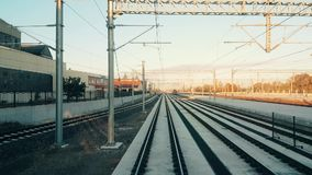 Passenger train arriving to the station at Eskisehir early in the morning. Eskisehir, Turkey - October 09, 2017: Train approaching to the station in Eskisehir in stock video