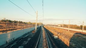 Passenger train arriving to the station at Eskisehir early in the morning. Train approaching to the station in Eskisehir in a beautiful sunny morning, view from stock video footage