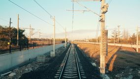 Passenger train arriving to the station at Eskisehir early in the morning. Train approaching to the station in Eskisehir in a beautiful sunny morning, view from stock footage