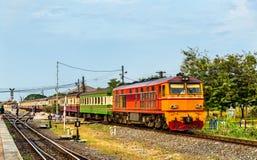 Passenger train for Bangkok departs from Ayutthaya station. Thailand stock images