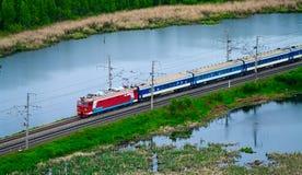 Passenger Train Between Lakes Royalty Free Stock Photography