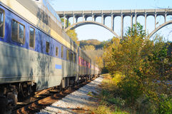 Passenger train and bridge stock image