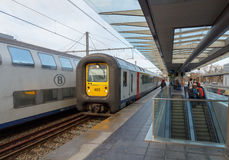 Passenger train. Bruges, Belgium - December 29, 2014: Passenger train near the platform of the railway station in the city of Bruges royalty free stock photos