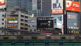 Passenger Train with Busy Street Traffic in Shinjuku - Tokyo Japan. Famous City of Shinjuku - Tokyo Japan stock video footage