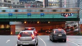 Passenger Train with Busy Street Traffic in Shinjuku - Tokyo Japan. Famous City of Shinjuku - Tokyo Japan stock footage