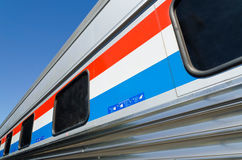 Passenger train car closeup. From the station's platform Royalty Free Stock Image