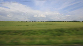 Passenger Train Countryside. V27. Side view from a passenger train of the countryside of Poland stock footage