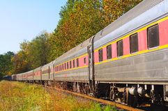 Passenger train on curve. A vintage passenger excursion train in a rural setting stock photography