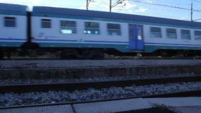 Passenger Train is Departing from a Station. From a Station of Pisa San Rossore stock footage