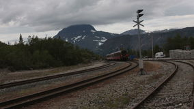 Passenger train departing from the train station stock video footage
