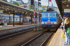 Passenger train departs from the main train station of Prague Royalty Free Stock Images