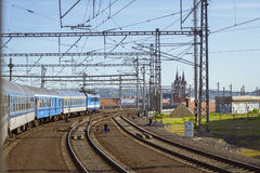 Passenger train departs from the main train station of Prague Stock Images