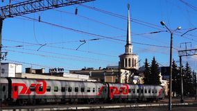 Passenger train departs from the platform of railway station. Passenger train departs from the platform of old railway station of soviet stalins empire stock video