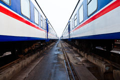 Passenger train at empty station Royalty Free Stock Images