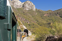 Passenger train entering mountain tunnel. El Chepe train entering Copper Canyon mountain tunnel in Chihuahua, Mexico Stock Photography