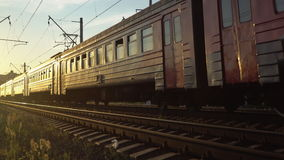 Passenger train fast running to the sunset. Moscow stock video footage