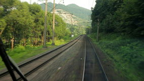 Passenger train goes to Carpathians (view from the machinist cab) stock video