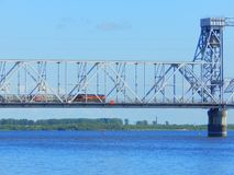 A passenger train going along a bridge in Arkhangelsk, Russia royalty free stock photos