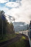 Passenger train going in the Carpathian Mountains Stock Image