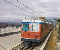 Passenger train of the Gornergrat Railway standing at the Gornergrat station. Gornegrat, Switzerland - September 16, 2018: a passenger train of the Gornergrat stock image