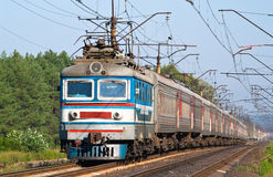 Passenger train hauled by electric locomotive Stock Images