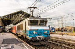Passenger train hauled by electric locomotive Royalty Free Stock Photos