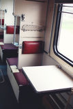 Passenger train from the inside, seat for passengers. Near window Royalty Free Stock Photo