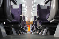 Passenger train interior. Modern speed train interior with blue seats stock photos