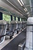 Passenger train interior with empty eats Royalty Free Stock Photos