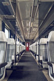 Passenger train interior with empty eats Stock Images