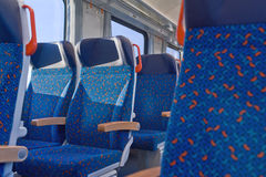 Passenger train interior with empty eats Royalty Free Stock Photos