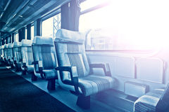 Passenger train interior with empty eats Royalty Free Stock Photo