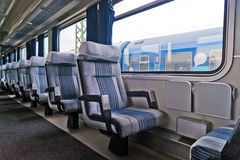 Passenger train interior with empty eats Stock Image