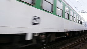 Passenger Train 4K. Passenger train is approaching the station. Audio is included stock footage